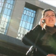 Businesswoman on mobile in city — Stock Video