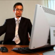 Vídeo Stock: Young businessmin modern working environment