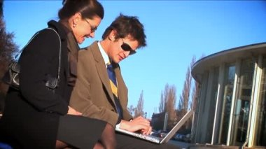 Wide shot of 2 businesspeople on laptop — Stock Video