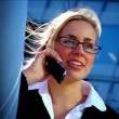Attractive blonde businesswoman working with technology - Stock Photo
