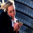 Attractive blonde businesswoman working with technology — Stock Video