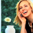 Beautiful blonde businesswoman works from home - Stock Photo