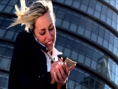 Attractive blonde businesswoman working with technology — Stock Video #19208833