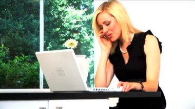 Beautiful blonde businesswoman works from home