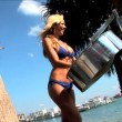 Beautiful sexy blonde woman having fun playing a drum — Stock Video