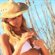 Beautiful blonde model posing for photo shoot on the beach — Stock Video