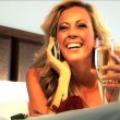 Attractive blonde woman on her hotel bed — Stock Video