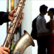 Romantic European couple in love with saxaphone player — Stock Video #19219255