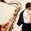 Romantic European couple in love with saxaphone player — Stock Video