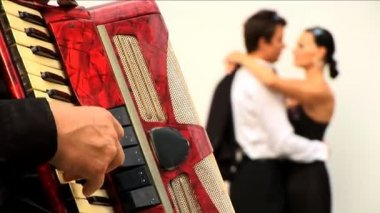 Romantic European couple in love with accordian player — Stock Video #19219277