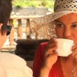 Attractive young couple drinking coffee together outdoors — Stock Video