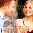 Attractive romantic couple drinking champagne — Vídeo de stock