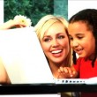 Cute little girl & beautiful blonde female work together on laptop — Stock Video #19222127