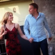 Young attractive couple walking to dinner holding hands — Stock Video