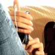 Beautiful latin girl on the sofa with her MP3 player — Stock Video