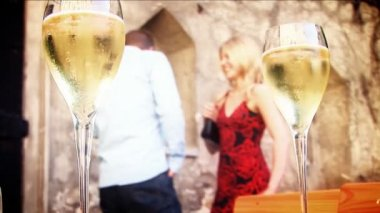 Romantic couple with champagne glasses in European location