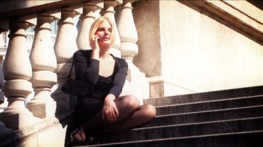 Beautiful blonde in business clothes using mobile phone — Stock Video
