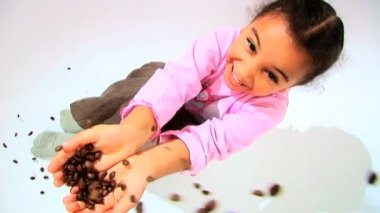 Little african american girl catching falling coffee beans — Stock Video