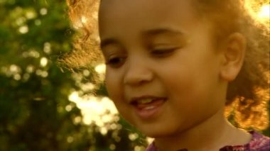 Little african american girl playing in a field of yellow rapeseed — Stock Video