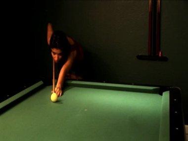 Beautiful latin girl playing pool & potting the black ball — Stock Video