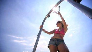 Beautiful young blonde girl having fun in speedboat in summer — Stock Video #19226421