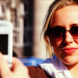 Young blonde girl in London as a tourist — Stock Video