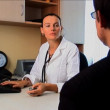 Doctor & patient discussing medical information & treatment — Stock Video