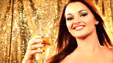 Portrait of a beautiful brunette girl with champagne — Stock Video