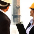 Environmental officers visiting industrial site for inspection - Foto Stock