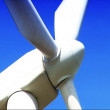 Wind power farm producing energy in the environment - Stock Photo