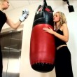 Beautiful  blonde girls boxing at the gym - Stock Photo