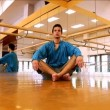 Young man practising yoga — Stock Video #19405041