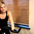 Beautiful blonde girl enjoys working out at the gym — Stock Video