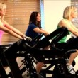 Beautiful girls enjoy working out at the gym — Vídeo Stock