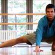Attractive young man practising yoga exercises at a gym — Stock Video