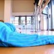 Stock Video: Attractive young man practising yoga exercises at a gym