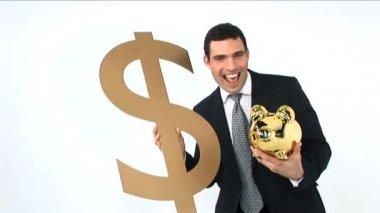 Businessman holding gold piggy bank and dollar symbol — Stock Video