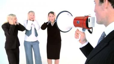 Businessman speaking throught a megaphone at his assistants — Stock Video