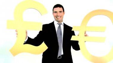 Businessman holding gold euro and pound symbol — Vidéo