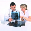 Healthworkers analyzing x-ray — Stock video