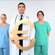 Medical team with euro symbol on white background - Foto de Stock  