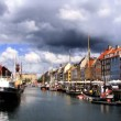 Nyhavn colored houses fronting waterways in Copenhagen - Stock Photo