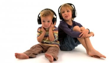 Two little caucasian boys listening to music — Stock Video