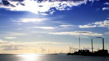 Wind turbines off the coast of Denmark under time-lapse clouds — Stock Video