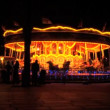 Fairground carousel at night in London at Christmas - Stock Photo