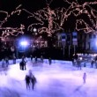 Winter outdoor ice skating with crowds of at night - Stok fotoğraf