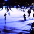 Stock Video: Winter outdoor ice skating with crowds of in silhouette