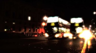 London transport double decker buses on the streets at night — Stock Video