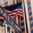 Wall Street & American flag flying New York — Stock Video