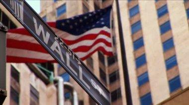 Wall Street & American flag flying New York — Stock Video